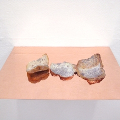 Caput Mortuum II (II). oil paint on aluminum foil, bread, copper, light. 45 x 31 x 6 cm, 2011