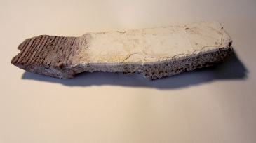 """2 (no.3). 2 found objects (brick, piece of concrete wall), glue, paint. approx. 12""""x3""""x2"""", 2014"""