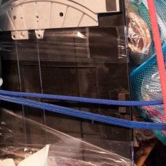 detail. found objects, rope, tape, zip-ties, wheels.