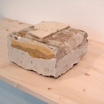 "wood'n blues (for JPKK and what is lost on the mantra). found concrete block, ""wood'n blues"", personally used iPod with headphones, 2013"
